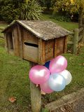 Birthday balloons. Tied to letterbox Stock Images