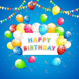 Birthday balloons and tinsel on blue holiday background Royalty Free Stock Photography
