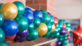 Birthday baloons in different colours. Latex Birthday baloons in different colours, blue, yellow, green. Balloon Arche stock photo