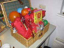 A birthday basket filled with presents royalty free stock photography