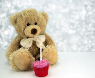 Birthday Bear. Cute teddy with cake and candle Royalty Free Stock Image