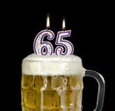 Birthday Beer for 65th Birthday Royalty Free Stock Image