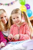 Birthday: Birthday Girl Making Craft At Party Royalty Free Stock Images