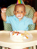 Birthday boy. 1 year old eating birthday cake Stock Photo