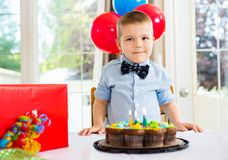 Birthday Boy With Cake And Present On Table stock image