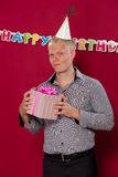 Birthday boy with gift Stock Images