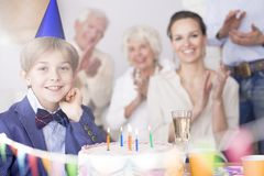 Birthday boy and his family. Happy birthday boy and his family having a party royalty free stock images