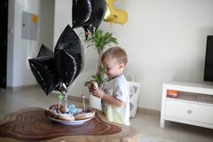 Birthday boy is looking at his birthday donuts royalty free stock images