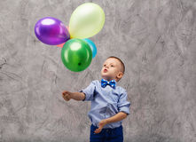 Birthday boy with multi-colored balloons Stock Image