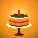 Birthday Cake. Two layer cake with a burning candle Stock Image