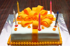 Birthday Cake. White-Orange birthday cake with candles Royalty Free Stock Photography