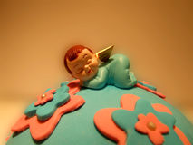 Birthday cake. A birthday cake decorated with angel baby figure Royalty Free Stock Photography