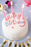 A birthday cake. With white icing and candles Royalty Free Stock Photos