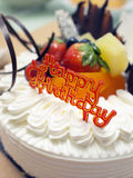 Birthday Cake. Closeup of the happy birthday tag on a fruit cake Royalty Free Stock Image