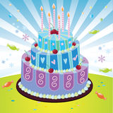 Birthday cake. Three-tier birthday cake decorated in pastel swirls, stripes, polka-dots and flowers for the ultimate birthday celebration with some candles Royalty Free Stock Photos