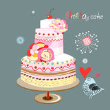 Birthday cake. Bright colored birthday cake with a bird on a dark blue background Stock Images