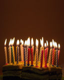 Birthday cake. Background of lighted candles on top of birthday cake Stock Image