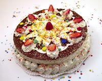Birthday cake 4. Colourful birthday cake with candles, white background royalty free stock photo