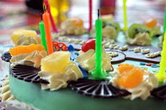 Birthday cake. A colorful birthday cake with candles Stock Photography