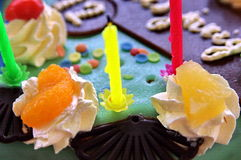 Birthday cake. A colorful birthday cake, cream decorations and candles Royalty Free Stock Photos