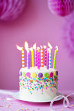 Birthday cake. Against a party background Stock Images