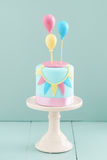 Birthday cake with balloons Royalty Free Stock Image