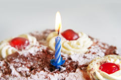 Birthday cake with blue candle Royalty Free Stock Image