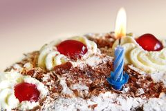 Birthday cake with blue candle Stock Photo