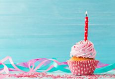 Birthday cake on blue wooden background stock photography