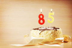 Birthday cake with burning candle as a number eighty five Royalty Free Stock Image