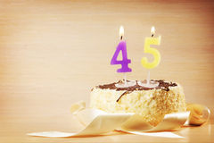 Birthday cake with burning candle as a number forty five Royalty Free Stock Photos