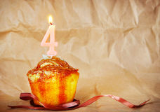 Birthday cake with burning candle as number four Stock Photo
