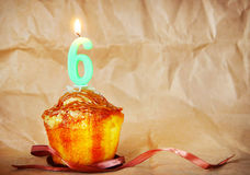 Birthday cake with burning candle as number six Royalty Free Stock Photography