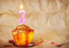 Birthday cake with burning candle as number three Royalty Free Stock Image