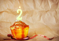 Birthday cake with burning candle as number two Stock Image