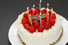 Birthday cake with burning candles Royalty Free Stock Image