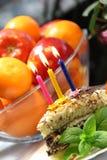 Birthday cake with burning candles Royalty Free Stock Photo
