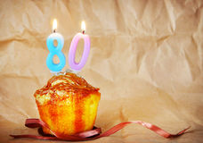 Birthday cake with burning candles as number eighty Royalty Free Stock Photography