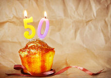Birthday cake with burning candles as number fifty Royalty Free Stock Photo