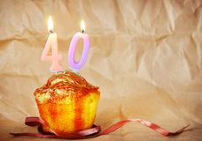 Birthday cake with burning candles as number forty Stock Photos