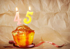 Birthday cake with burning candles as number forty five Royalty Free Stock Image