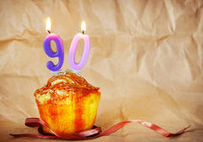 Birthday cake with burning candles as number ninety Royalty Free Stock Images