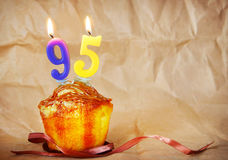 Birthday cake with burning candles as number ninety five Stock Images