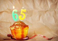 Birthday cake with burning candles as number sixty five Royalty Free Stock Image