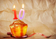 Birthday cake with burning candles as number ten Stock Photography