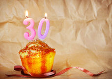Birthday cake with burning candles as number thirty Stock Photos