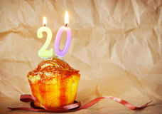 Birthday cake with burning candles as number twenty Stock Images