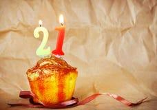 Birthday cake with burning candles as number twenty one Stock Photo