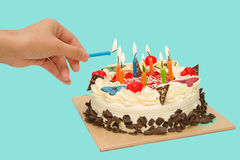 Birthday cake with burning candles Stock Image