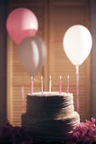 Birthday cake with burning candles on wooden background; Royalty Free Stock Images
